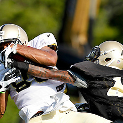 July 29, 2012; Metairie, LA, USA; New Orleans Saints rookie wide receiver Nick Toon (88) makes a catch over cornerback Elbert Mack (44) during a training camp practice at the team's practice facility. Mandatory Credit: Derick E. Hingle-US PRESSWIRE