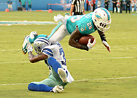 August 23rd, 2014, Miami Dolphins running back Lamar Miller (26) is tackle by Dallas Cowboys cornerback Brandon Carr (39) during a game between the Miami Dolphins and the Dallas Cowboys at Sun Life Stadium in Miami Garden, FL NFL American Football Herren USA AUG 23 Preseason - Cowboys at Dolphins PUBLICATIONxINxGERxSUIxAUTxHUNxRUSxSWExNORxONLY Icon140823017<br /> <br /> August 23rd 2014 Miami Dolphins Running Back Lamar Miller 26 is Tackle by Dallas Cowboys Cornerback Brandon Carr 39 during A Game between The Miami Dolphins and The Dallas Cowboys AT Sun Life Stage in Miami Garden Fl NFL American Football men USA Aug 23 Preseason Cowboys AT Dolphins PUBLICATIONxINxGERxSUIxAUTxHUNxRUSxSWExNORxONLY