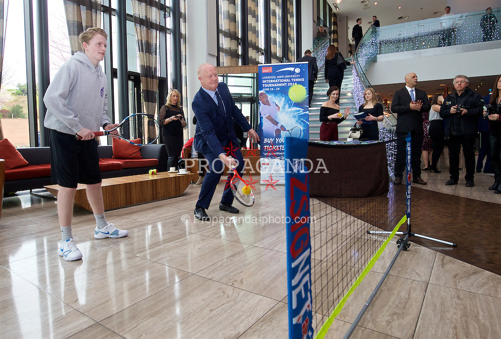LIVERPOOL, ENGLAND - Monday, April 18, 2016: Mark Wright plays mini-tennis in the lobby of the Hilton Hotel before the launch of the 2016 Liverpool Hope University International Tennis Tournament at the Hilton Hotel. (Pic by David Rawcliffe/Propaganda)