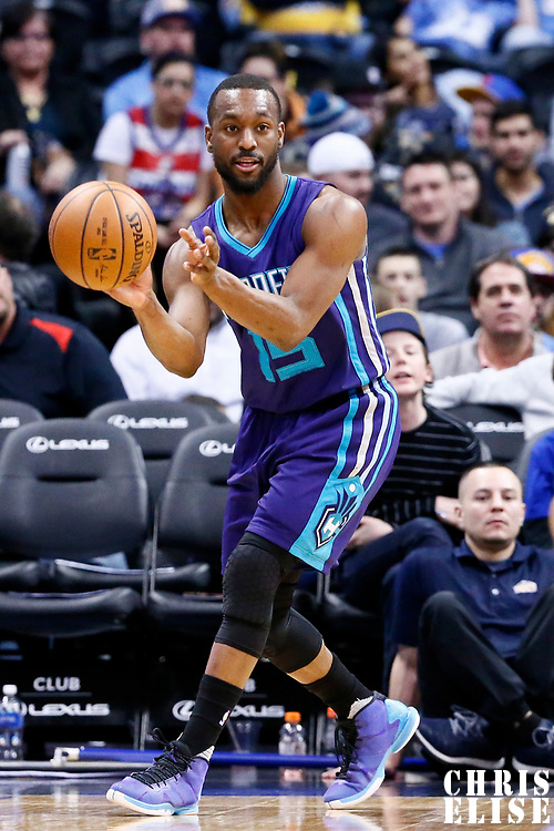 04 March 2017: Charlotte Hornets guard Kemba Walker (15) passes the ball during the Charlotte Hornets 112-102 victory over the Denver Nuggets, at the Pepsi Center, Denver, Colorado, USA.