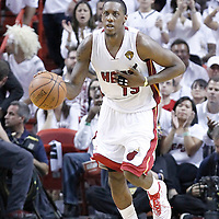 21 June 2012: Miami Heat point guard Mario Chalmers (15) brings the ball upcourt during the Miami Heat 121-106 victory over the Oklahoma City Thunder, in Game 5 of the 2012 NBA Finals, at the AmericanAirlinesArena, Miami, Florida, USA. The Miami Heat wins the series 4-1.
