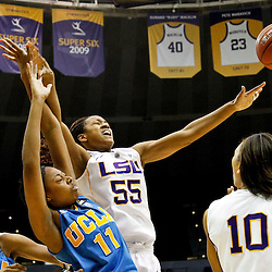 December 13, 2011; Baton Rouge, LA; LSU Lady Tigers forward LaSondra Barrett (55) loses a rebound as UCLA Bruins forward Atonye Nyingifa (11) defends during the first half of a game at the Pete Maravich Assembly Center.  Mandatory Credit: Derick E. Hingle-US PRESSWIRE