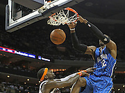 CHARLOTTE - APRIL 24:  Center Dwight Howard #12 of the Orlando Magic dunks on guard Stephen Jackson #1 of the Charlotte Bobcats during Game Three of the Eastern Conference Quarterfinals during the 2010 NBA Playoffs at Time Warner Cable Arena on April 24, 2010 in Charlotte, North Carolina. NOTE TO USER: User expressly acknowledges and agrees that, by downloading and/or using this photograph, user is consenting to the terms and conditions of the Getty Images License Agreement.  The Magic beat the Bobcats 90-86.  (Photo by Mike Zarrilli/Getty Images) *** Local Caption *** Dwight Howard; Stephen Jackson