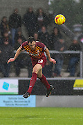 Bradford City defender Rory McArdle clears the ball as the rain falls heavily during the Sky Bet League 1 match between Burton Albion and Bradford City at the Pirelli Stadium, Burton upon Trent, England on 6 February 2016. Photo by Aaron Lupton.