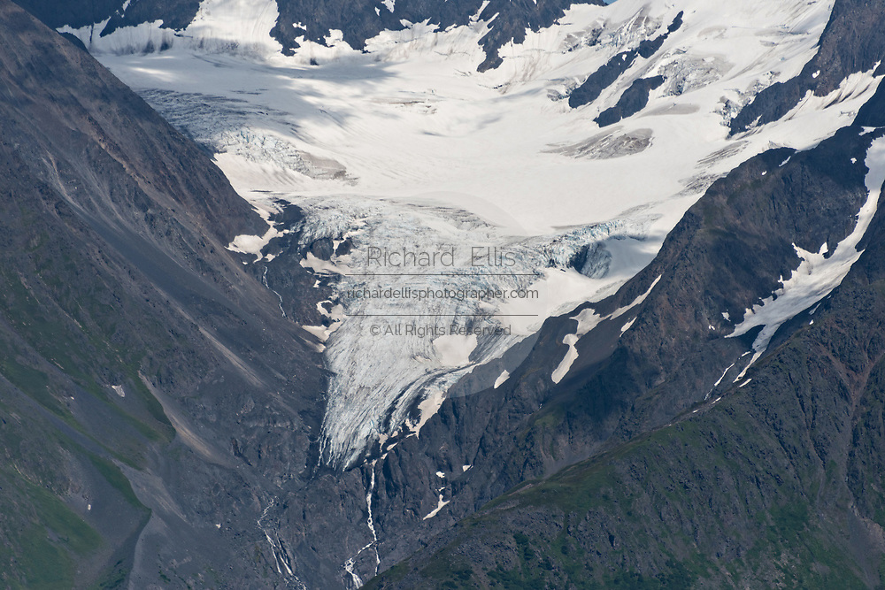 A hanging glacier in the Chugach Mountains in Girdwood, Alaska. A hanging glacier results from the melting of a major valley glacier system leaving behind tributary glaciers that appear to hang from the mountain.