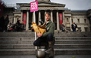 Tristram Stuart &amp; Thomasina Miers pose at Trafalgar Square on November 21st 2013.<br /> <br /> Top British chefs cook free lunch for all at The Pig Idea Feast <br /> In support of campaign to put food waste back on the menu for pigs in the UK<br />  12 noon to 4pm on 21st November 2013, in Trafalgar Square, London<br /> <br /> Top chefs and award winning restaurants will be cooking up a piggy-licious lunch at The Pig Idea Feast, between 12 noon to 4pm, on Thursday 21st November, in Trafalgar Square, London, in a bid to get food waste back on the menu for pigs in the UK.  Hugh Fearnley-Whittingstall, Thomasina Miers, Valentine Warner and DJ Sara Cox will be among the big names making dishes in support of the campaign.<br /> <br /> Members of the public will be able to turn up and enjoy a free lunch prepared by famous chefs from top London restaurants &ndash; Wahaca, Bistrot Bruno Loubet, Cabana, The Delaunay, Paternoster Chop House, Le Pont de la Tour and Soho House &ndash; with an array of dishes from Braised Pig&rsquo;s Cheeks to Pork Belly Pizza. <br /> 13.<br /> <br /> Photo Ki Price for Greenhouse PR