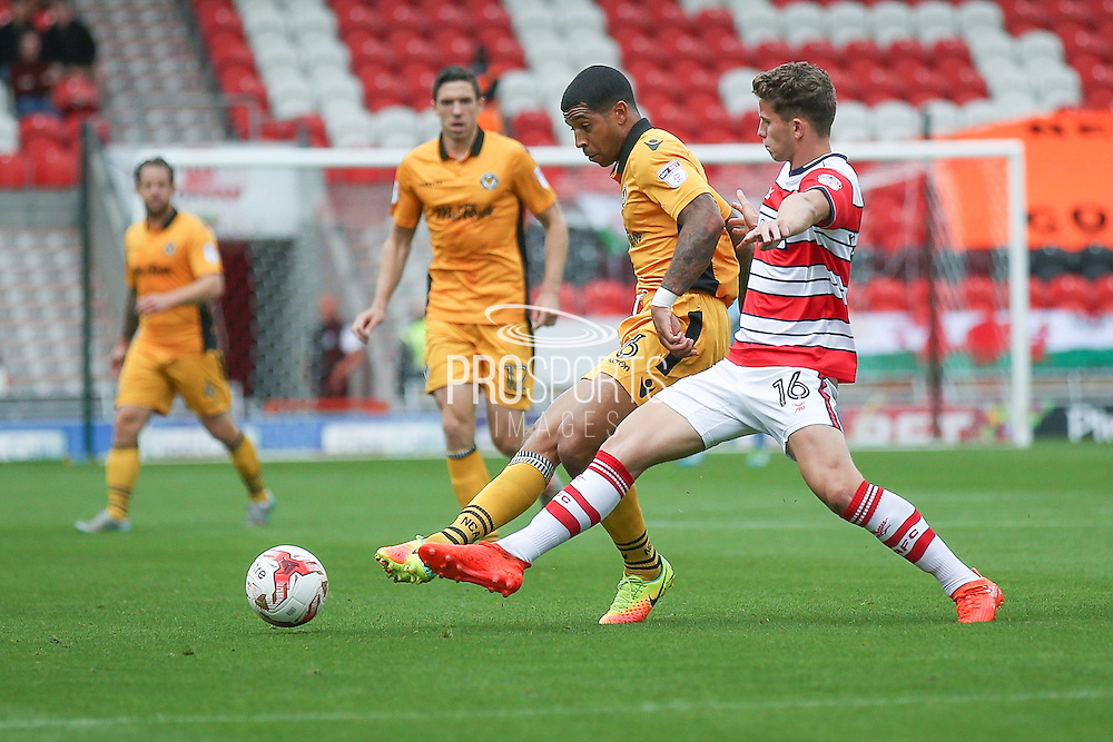 Newport County  midfielder Joss Labadie (6) gets the ball away ahead of Doncaster Rovers midfielder, on loan from Chelsea, Jordan Houghton (16)  during the EFL Sky Bet League 2 match between Doncaster Rovers and Newport County at the Keepmoat Stadium, Doncaster, England on 17 September 2016. Photo by Simon Davies.