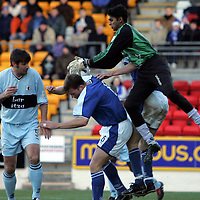 St Johnstone v Raith Rovers..26.12.04<br />Rudy Pounoussamy drops the ball under pressure from Michael Moore and Ian Maxwell, which led to Ian Maxwell's goal<br />Picture by Graeme Hart.<br />Copyright Perthshire Picture Agency<br />Tel: 01738 623350  Mobile: 07990 594431