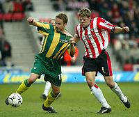 Photo: Scott Heavey<br />Southampton V West Bromwich Albion. 01/03/03.<br />Goalscorer James Beattie (right) battles with Larus Sigurdsson during this premiership clash at St. Marys stadium, home of Southampton.