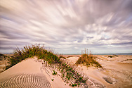Long exposure landscape of dunes, ocean and clouds at Oregon Inlet in Outer Banks, North Carolina