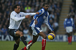 PORTSMOUTH, ENGLAND - SATURDAY, DECEMBER 9th, 2006: Kanu of Portsmouth clashes with Joleon Lescott  of Everton during the Premiership match at Fratton Park. (Pic by Chris Ratcliffe/Propaganda)