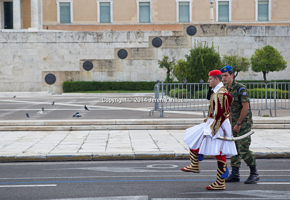 An Evzones marches during the Changing of the Guard ceremony in front of the Old Royal Palace in Syntagma Square, Athens. The official ceremony is held every Sunday at 11 AM.