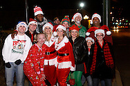 A group photo outside the Dublin Pub, the first stop of the Santa Pub Crawl through the Historic Oregon District near downtown Dayton, Saturday, December 10, 2011.