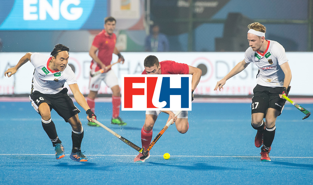 BHUBANESWAR - The Odisha Men's Hockey World League Final . Match ID 01 . Germany v England (2-0). Phil Roper (Eng)  between Dan Nguyen (Ger) and Christopher Ruehr (Ger) . WORLDSPORTPICS COPYRIGHT  KOEN SUYK