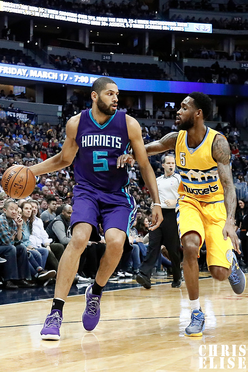 04 March 2017: Charlotte Hornets guard Nicolas Batum (5) drives past Denver Nuggets guard Will Barton (5) during the Charlotte Hornets 112-102 victory over the Denver Nuggets, at the Pepsi Center, Denver, Colorado, USA.