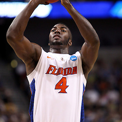 Mar 17, 2011; Tampa, FL, USA; Florida Gators forward/center Patric Young (4) during first half of the second round of the 2011 NCAA men's basketball tournament against the UC Santa Barbara Gauchos at the St. Pete Times Forum.  Mandatory Credit: Derick E. Hingle