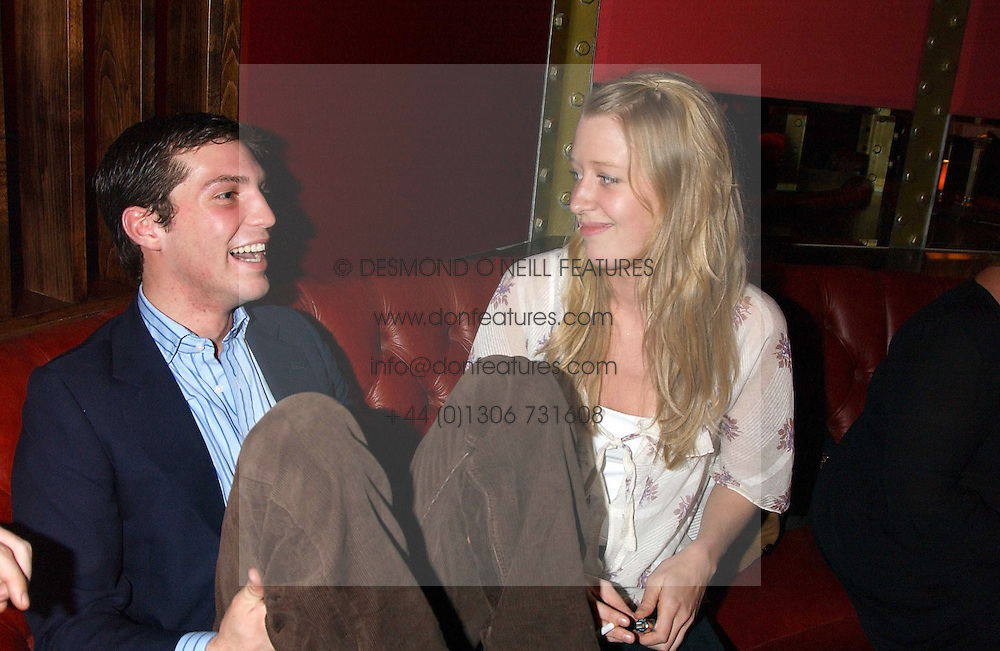 WILLIAM AITKEN and ALICE ROTHSCHILD at the opening party for a new bowling alley All Star Lanes, at Victoria House, Bloomsbury Place, London on 19th January 2006.<br />