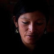 A portrait of Cholita wrestler Yolanda La Amorosa at her home in La Paz. Yolanda is part of the 'Titans of the Ring' wrestling group who perform every  Sunday at El Alto's Multifunctional Centre. Bolivia. The wrestling group includes the fighting Cholitas, a group of Indigenous Female Lucha Libra wrestlers who fight the men as well as each other for just a few dollars appearance money. El Alto, Bolivia, 24th March 2010. Photo Tim Clayton