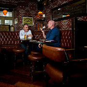 10.08.2016<br /> Alan English,Author and former Munster and Irish Rugby Captain, Paul O'Connell, collaborating on Pauls book over a drink at Jerry Flannerys Bar. Picture: Alan Place