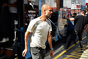 Manchester City manager Pep Guardiola gets off the team bus on arrival to the Vitality Stadium ahead of the Premier League match between Bournemouth and Manchester City at the Vitality Stadium, Bournemouth, England on 25 August 2019.