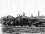 London & South Western Railway (LSWR) Locomotive No 5, 'Ganymede' and tender.  This 2-4-0 steam locomotive was built  in the LSWR's workshops at Nine Elms, south London,  in 1873. Photograph.