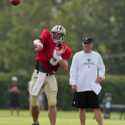 01 August 2009: New Orleans Saints quarterback Drew Brees (9) throws a pass as offensive coordinator Pete Carmichael Jr. watches during New Orleans Saints training camp at the team's practice facility in Metairie, Louisiana.