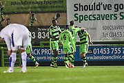 Players congratulate Forest Green Rovers  goalscorer Liam Noble(15) during the Vanarama National League match between Forest Green Rovers and Tranmere Rovers at the New Lawn, Forest Green, United Kingdom on 22 November 2016. Photo by Shane Healey.