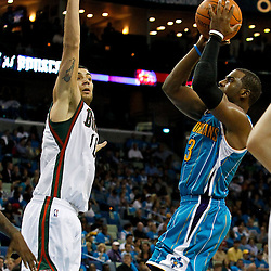 October 27, 2010; New Orleans, LA, USA; New Orleans Hornets point guard Chris Paul (3) shoots over Milwaukee Bucks small forward Carlos Delfino (10) of Argentina  during the second half at the New Orleans Arena. The Hornets defeated the Bucks 95-91.  Mandatory Credit: Derick E. Hingle