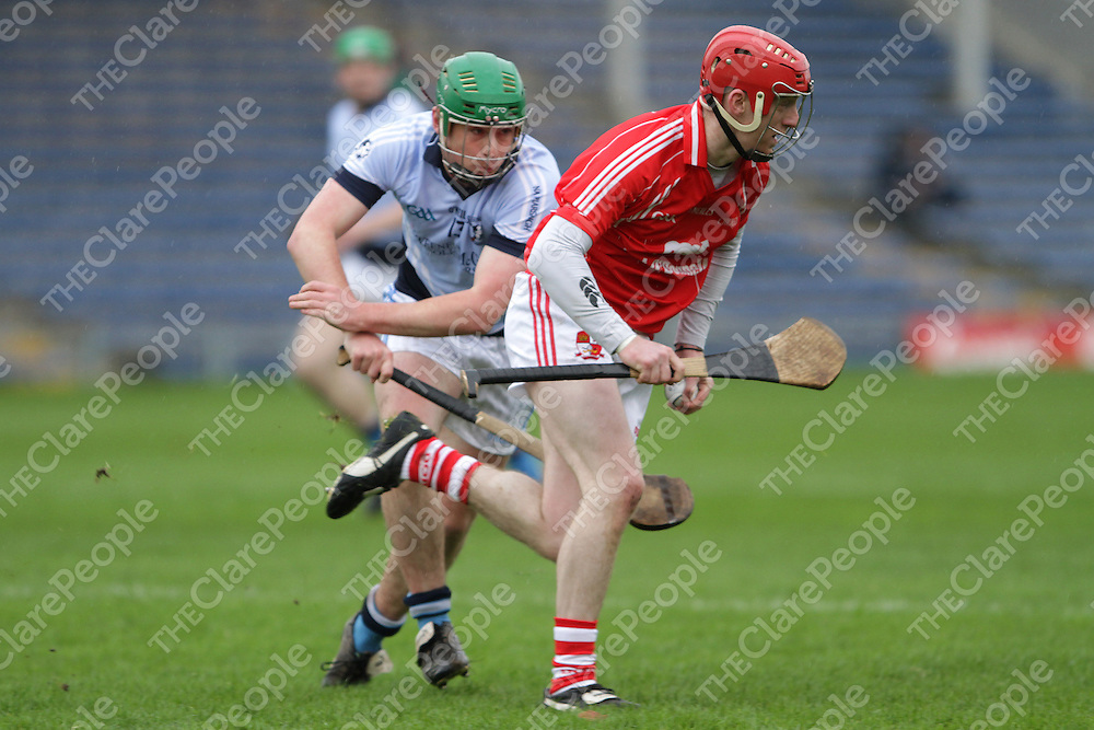 John Brigdale Crusheen gives Kieran Kennedy Na Piaraigh the slip as he comes away with possession in the Munster Club Senior Hurling replay. - Photograph by Flann Howard