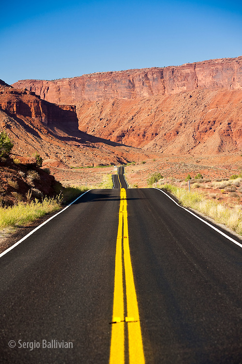 The paved and curvy Route 128 cuts its way through the red sandstone canyons near Moab, Utah.