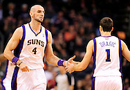Nov. 21, 2012; Phoenix, AZ, USA; Phoenix Suns center Marcin Gortat (4) is congratulated by guard Goran Dragic (1)  during the game against the Portland Trail Blazers in the first half at US Airways Center. Mandatory Credit: Jennifer Stewart-US PRESSWIRE