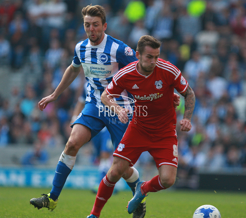 Cardiff City midfielder Joe Ralls shields the ball from Brighton central midfielder Dale Stephens during the Sky Bet Championship match between Brighton and Hove Albion and Cardiff City at the American Express Community Stadium, Brighton and Hove, England on 3 October 2015. Photo by Bennett Dean.