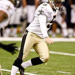 August 21, 2010; New Orleans, LA, USA; New Orleans Saints place kicker Garrett Hartley (5) kicks off during the first quarter of a preseason game against the Houston Texans at the Louisiana Superdome. Mandatory Credit: Derick E. Hingle