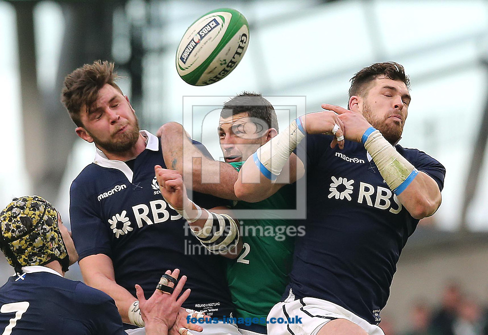 Picture by Lorraine O'Sullivan/Focus Images Ltd +353 872341234<br /> 02/02/2014<br /> Rob Kearney of Ireland with Ryan Wilson and Sean Lamont during the RBS 6 Nations match at the Aviva Stadium, Dublin.