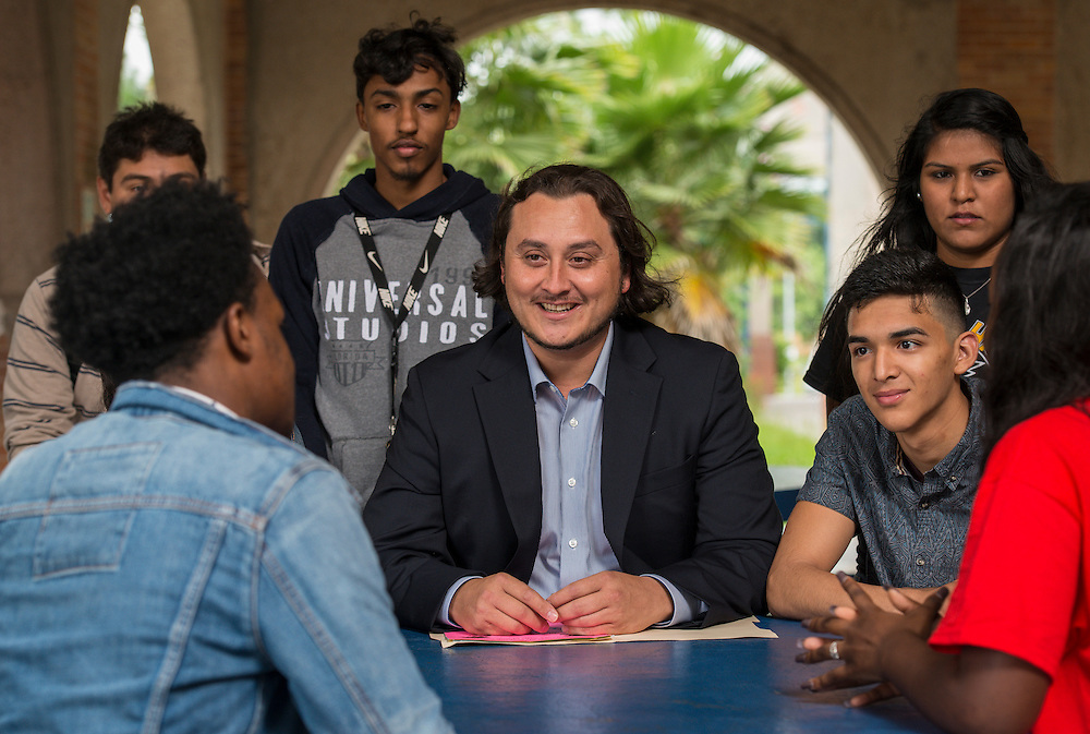 Orlando Reyna talks with students at Madison High School, May 22, 2015.