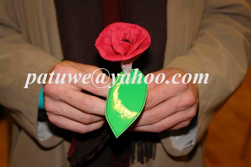 Man holding paper flower
