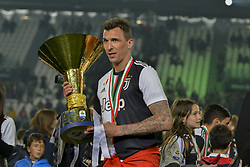 May 19, 2019 - Turin, Turin, Italy - Mario Mandzukic of Juventus FC lifts the trophy of Scudetto  2018-2019 at Allianz Stadium, Turin  (Credit Image: © Antonio Polia/Pacific Press via ZUMA Wire)