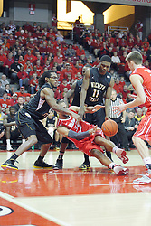 17 February 2013:  Jackie Carmichael gets twisted up by Carl Hall and Cleanthony Early during an NCAA Missouri Valley Conference mens basketball game where the Shockers of Wichita State played the Illinois State Redbirds  in Redbird Arena, Normal IL