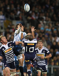 CAPE TOWN, SOUTH AFRICA - 11 JUNE 2011, Bulls wing Gerhard van den Heever and Stormers flyhalf Kurt Coleman challenge for the high ball during the Super Rugby match between DHL Stormers and the Bulls held at DHL Newlands Stadium in Cape Town, South Africa..Photo by Shaun Roy / Sportzpics.net