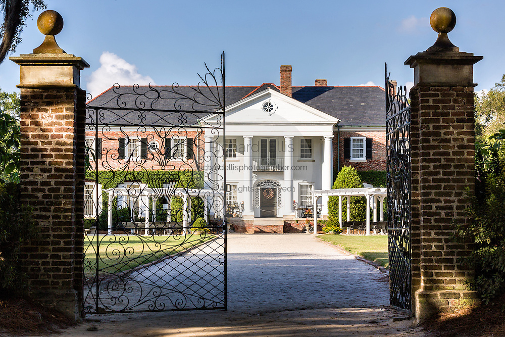 The Colonial Revival plantation house and wrought iron decorative gates at Boone Hall Plantation in Mt Pleasant, South Carolina.