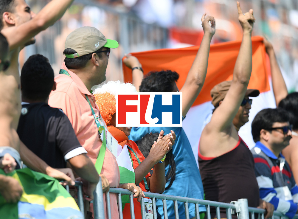 India fans cheer during the men's field hockey Argentina vs India match of the Rio 2016 Olympics Games at the Olympic Hockey Centre in Rio de Janeiro on August, 9 2016. / AFP / MANAN VATSYAYANA        (Photo credit should read MANAN VATSYAYANA/AFP/Getty Images)
