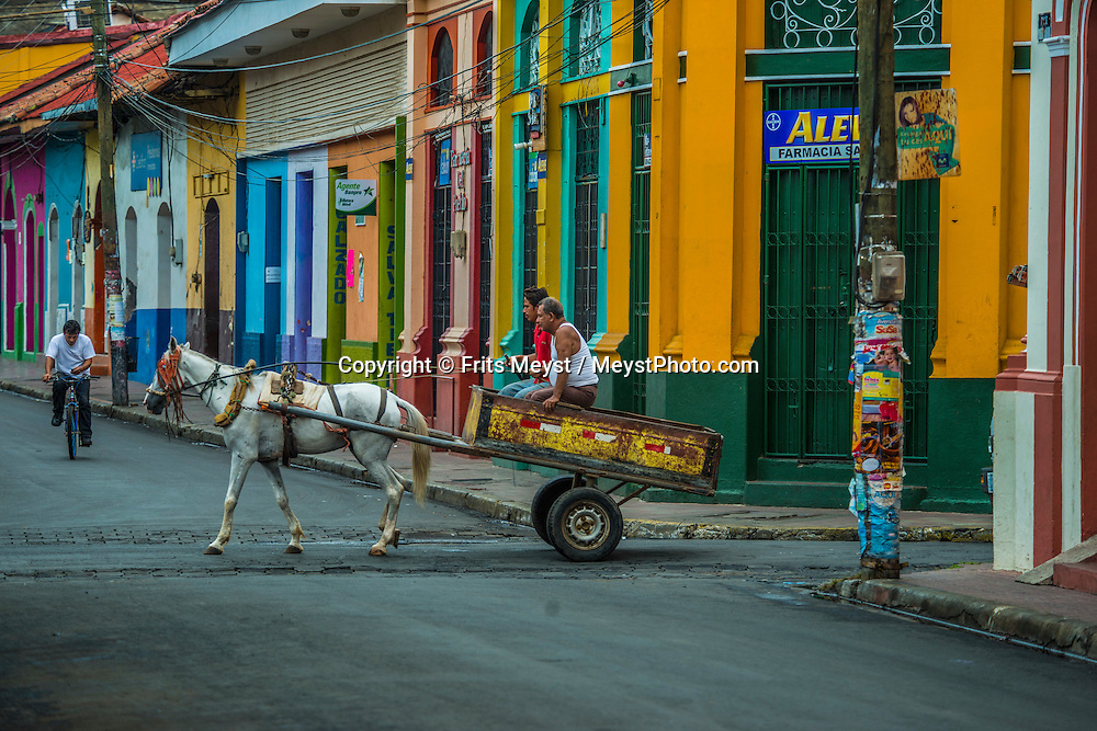 Leon; Nicaragua; May 2014. a Horse cart in the colourful streets of leon. León is the second largest city in Nicaragua. It was founded by the Spaniards as León Santiago de los Caballeros and rivals Granada; Nicaragua; in the number of historic Spanish colonial churches; secular buildings; and private residences. Central America's largest and least populated country consists of lakes; volcanoes and Spanish colonial cities. Photo by Frits Meyst / MeystPhoto.com