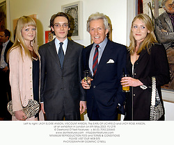 Left to right, LADY ELOISE ANSON, VISCOUNT ANSON, The EARL OF LICHFIELD and LADY ROSE ANSON, at an exhibition in London on 6th May 2003.	PJI 218