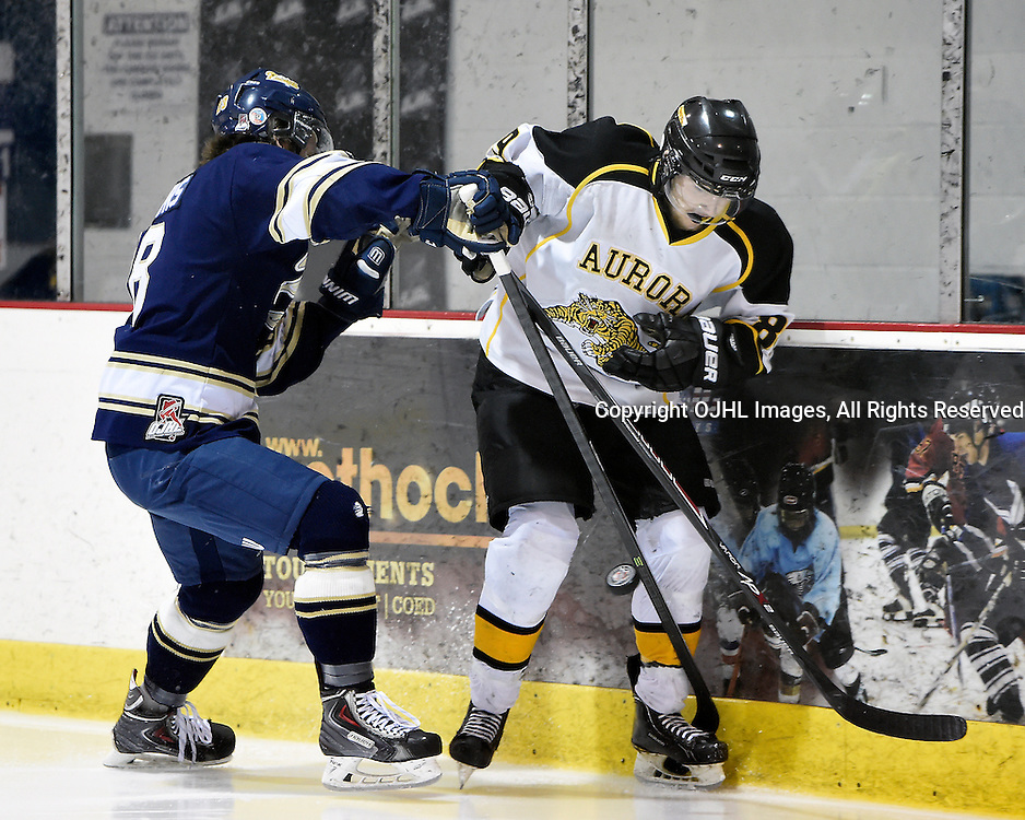 TORONTO, ON - Apr 10 : Ontario Junior Hockey League, Buckland Cup Championship Series between the Aurora Tigers and the Toronto Lakeshore Patriots, Robert Powers #18 of the Toronto Lakeshore Patriots tries to keep the puck from Calvin Higley #89 of the Aurora Tigers during first period game action.<br /> (Photo by Andy Corneau / OJHL Images)