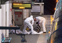 © Licensed to London News Pictures. 24/09/2019. London, UK. A Metropolitan Line train stands at Hillingdon train station as forensic investigators gather evidence after a person was stabbed to death. Photo credit: Peter Manning/LNP