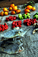GHANA,Accra,Kokomlemle, 2007. Staples in a varied diet, locally grown peppers and salted fish complement cassava and potatoes.