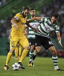 October 31, 2017 - Lisbon, Portugal - Juventus's forward Gonzalo Higuain (L) vies with Sporting's midfielder Joao Palhinha during the Champions League  football match between Sporting CP and Juventus FC at Jose Alvalade  Stadium in Lisbon on October 31, 2017. (Credit Image: © Carlos Costa/NurPhoto via ZUMA Press)