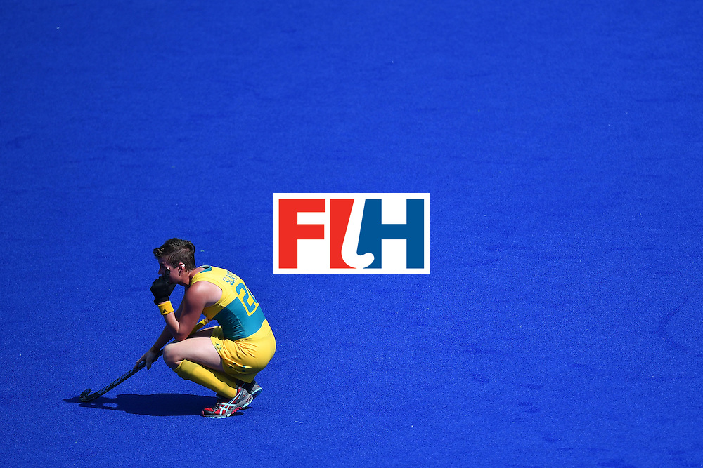 Australia's Kathryn Slattery croaches down at the end of the women's quarterfinal field hockey New Zealand vs Australia match of the Rio 2016 Olympics Games at the Olympic Hockey Centre in Rio de Janeiro on August 15, 2016. / AFP / MANAN VATSYAYANA        (Photo credit should read MANAN VATSYAYANA/AFP/Getty Images)