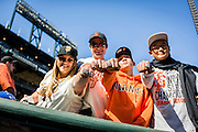 SAN FRANCISCO, CA - APRIL 18: San Francisco Giants fans show off their replica World Series rings prior to San Francisco Giants World Series ring ceremony at AT&T Park on Saturday, April 18 2015 in San Francisco, California. Photo by Jean Fruth