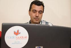 Bulgarian man using a laptop computer,